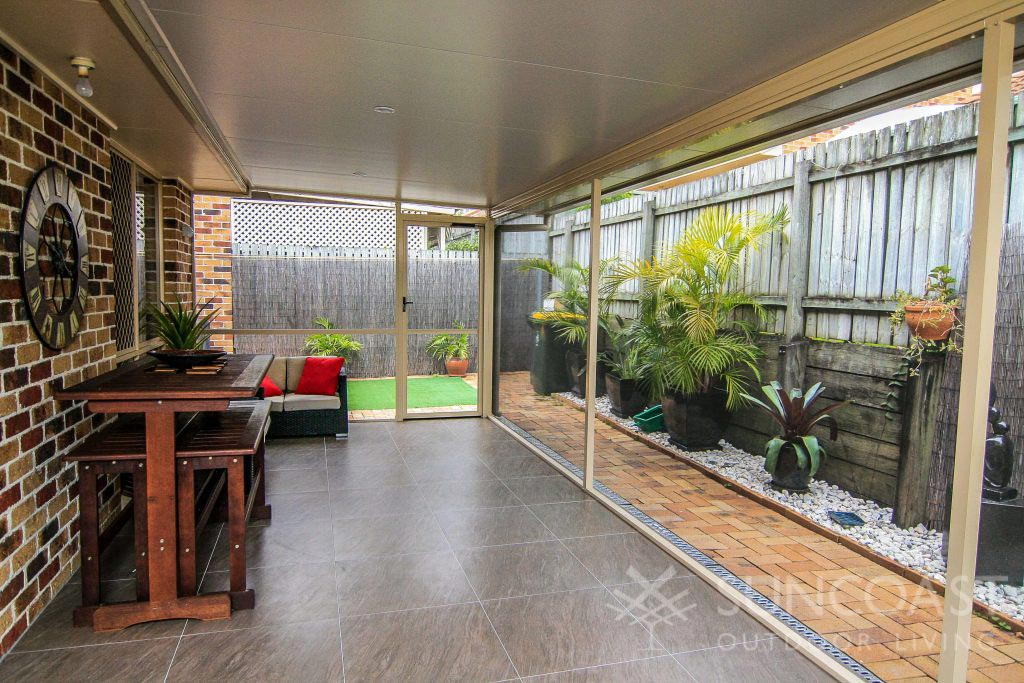 Enclosed patio area with lounge and dining area