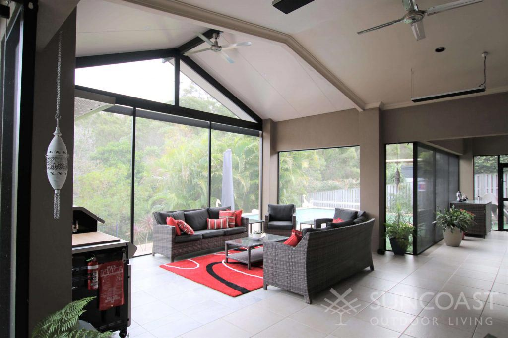 Enclosed patio area with lounge and BBQ in Upper Coomera