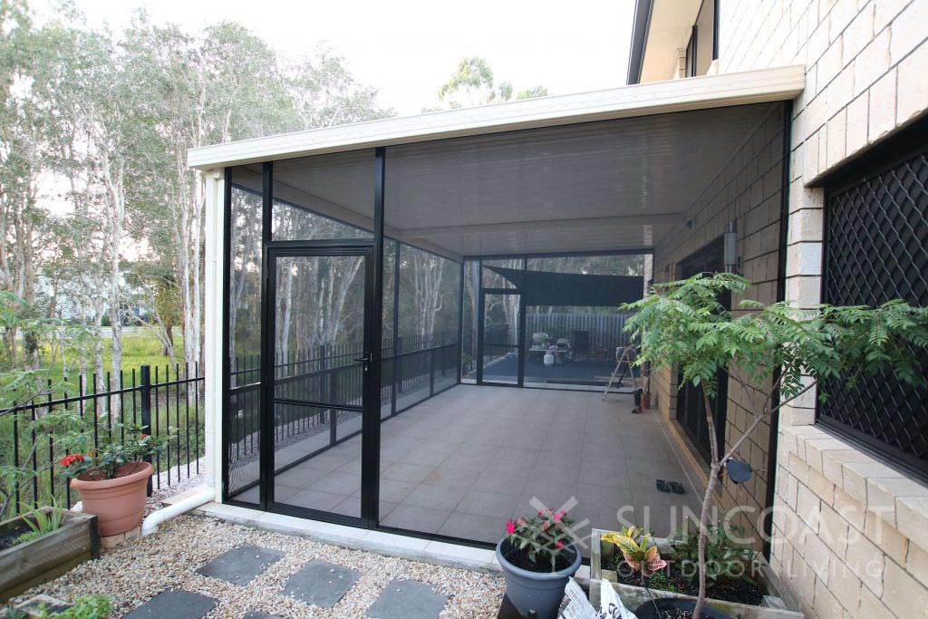 Tiled patio area enclosed with mesh screens