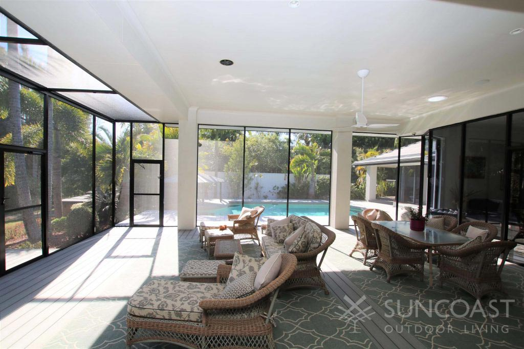 Large screened lounge and dining enclosure with access to pool