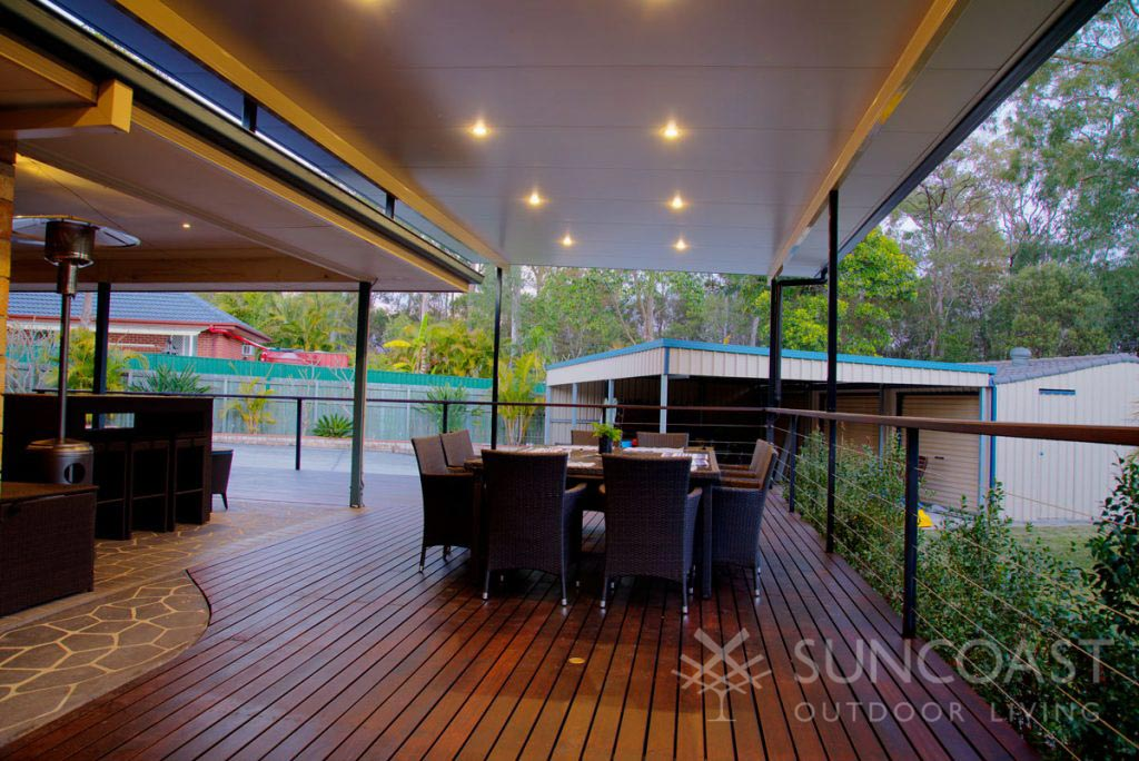 Outdoor BBQ and alfresco dining area with insulated patio roof