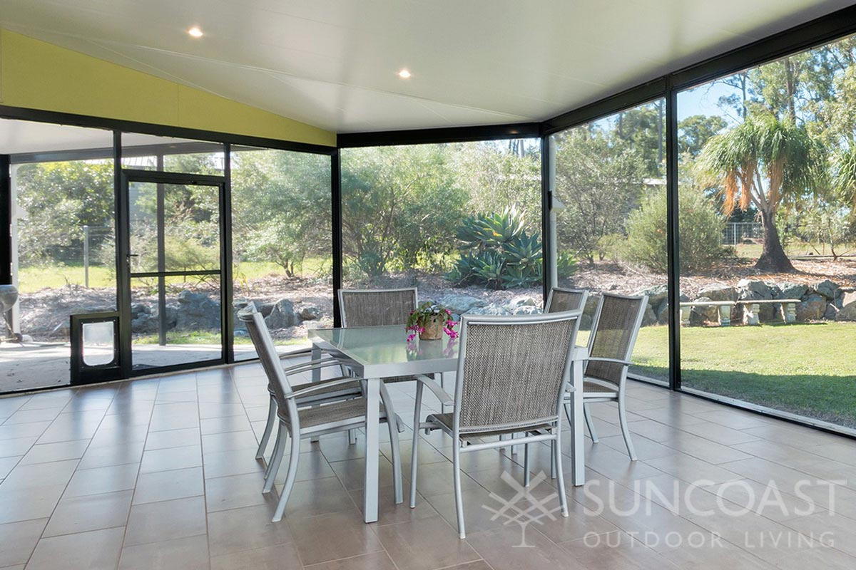 Screened enclosure with pet door and outdoor dining area