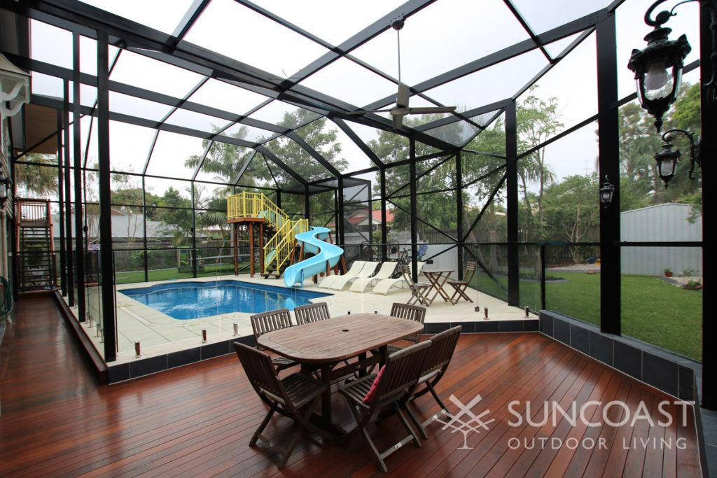 South East QLD mesh enclosure around pool, play and dining area.