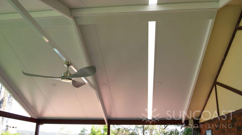 Skylight in insulated ceiling panels over patio area
